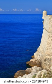 Blue sea and large walls defending the old town of Dubrovnik, Croatia