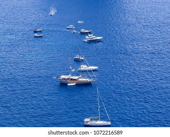 Blue sea and leisure boats seen from  from Augustus Gardens,Isle of Capri, Italy