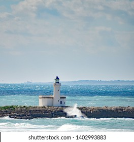 Blue sea and a lonely lighthouse in Trapani, Sicily