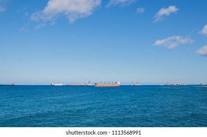 Blue sea with many ships in a sunny day.