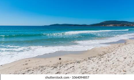 Blue sea in Maria Pia beach in Alghero. Sardinia, Italy
