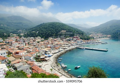 Blue sea, mountains and mediterranean houses on sunny day - Parga, Greece
