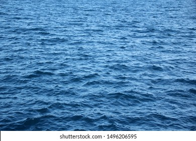 blue sea, ocean waves, water with foam and bubbles, texture, water natural resources concept, close-up, copy space