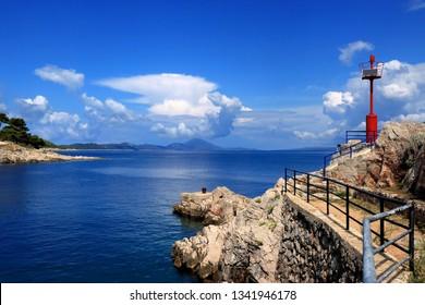 blue sea and red lighthouse in Veli Losinj, island Losinj, Crpatia