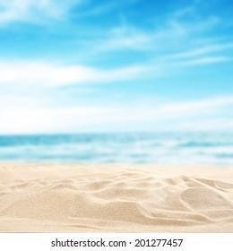 blue sea and sand with sun light