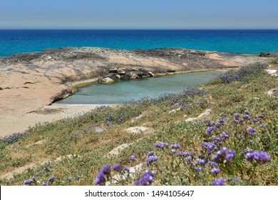 blue sea and sandy beach at Ahziv in northern Israel.