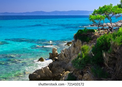 Blue sea shore under clear sky