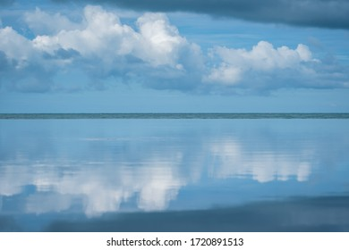 the blue sea with the sky with clouds