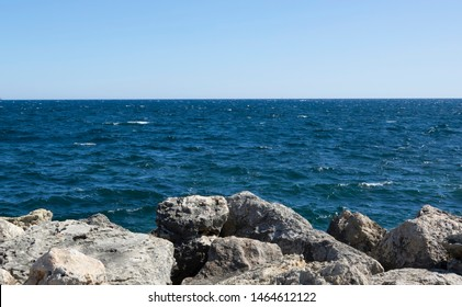 Blue sea, blue sky and coastal cliffs. Not suitable for swimming beach.