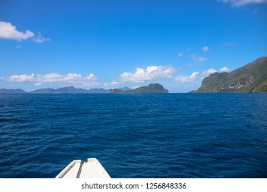 Blue sea and sky landscape. Tropical island hopping by white boat. El Nido Palawan island seascape. Island hopping tour. Sunny day on cruiseboat. Tropic vacation destination place. Marine trip banner