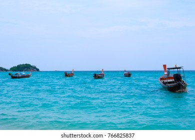 Blue sea with small boats for fishing