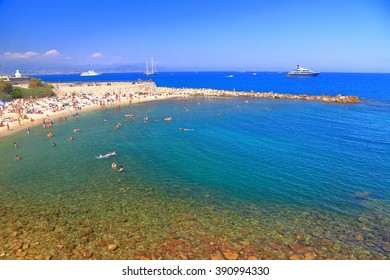 Blue sea and swimmers on a beach in Antibes, French Riviera, France