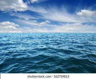 Blue sea water surface on sky - Shutterstock ID 562759813
