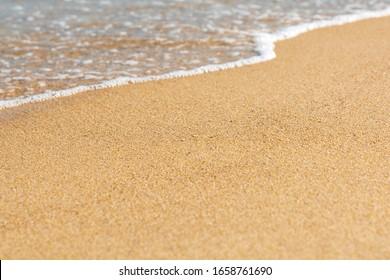 Blue sea wave on sandy beach. Travel background. Soft focus