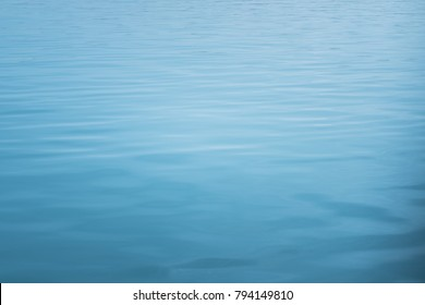 blue sea with waves and calm ocean water surface with small ripples