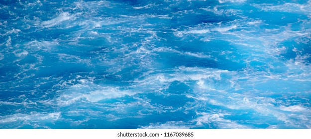 Blue sea with waves and foam