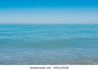 Blue sea waves soft surface. Summer abstract background pattern