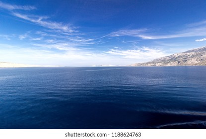 Blue sea, white island and blue sky background. Adriatic sea