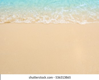 Blue sea and white sand with little wave