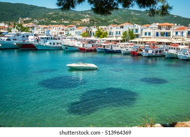 The blue sea with yachts and boats on the water, Skiathos, Greec