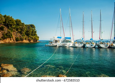 The blue sea with yachts and boats on the water, Skiathos, Greece