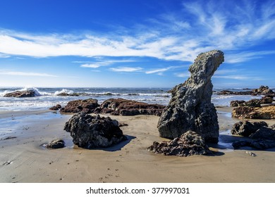 Blue seas & skies, white clouds, shimmering & reflective tidal pools, rock and unusual geological formations, at Estero Bluffs state park. Big Sur Highway (Highway 1), on the California Central Coast.