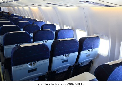 Blue seats of economy class in airplane