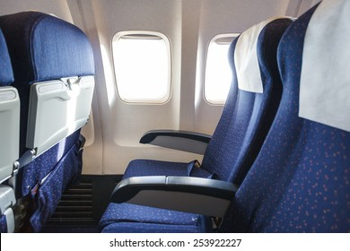 blue seats in economy class passenger section of aircraft