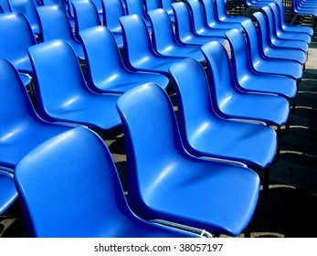 the blue seats of an outdoor cinema