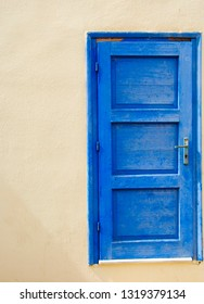 blue seperated door at a wall in Sissi on Crete in Greece