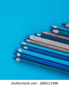 Blue shade colour pencels with blue background