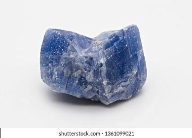 Blue shiny rough calcite mineral stone specimen isolated on white limbo background