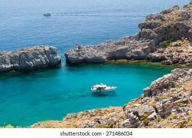 blue ship in bay Agios Pavlos, cove Agios Pavlos, island Rhodes, Greece,