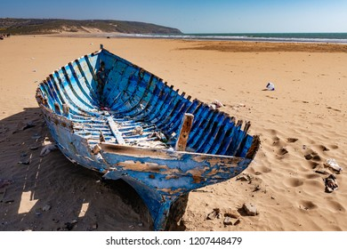 Blue shipwreck stranded on the beach of Tafelney, in the region of Essaouira in Morocco