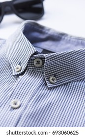 Blue shirt with sunglasses.Close up.Concept travel.Vertical