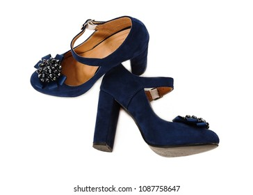 Blue shoes with bead bow on white background