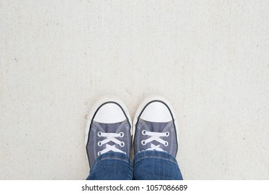 Blue shoes and jeans from above