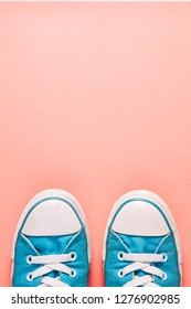 Blue shoes on a pink background