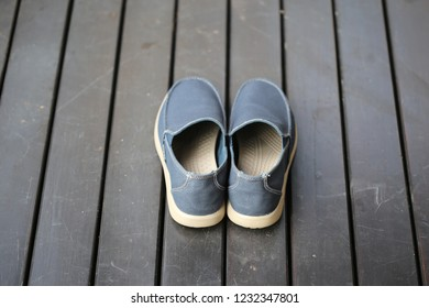 blue shoes on the wood floor
