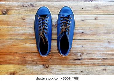 blue shoes top view on wood  background