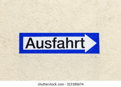 blue sign exit in german painted at a wall