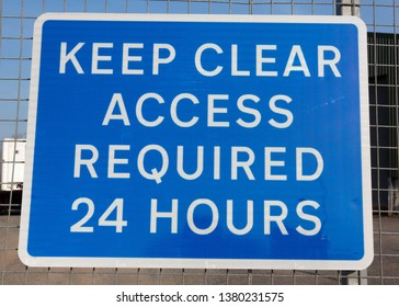 Blue sign indicating that access is required 24 hours a day.