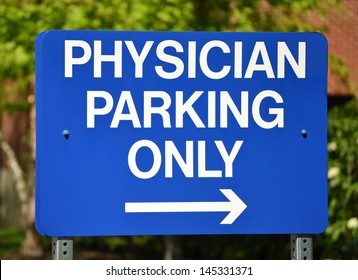 A blue sign that reads Physician Parking Only