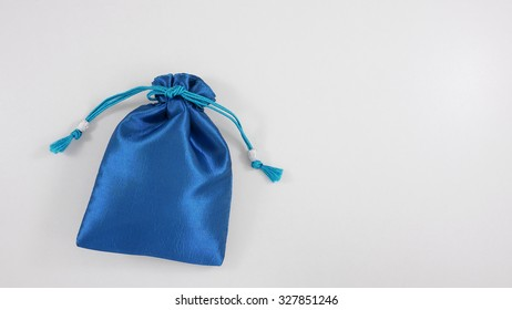 The blue silk mini gift pouch bag to hold jewelry. (1)