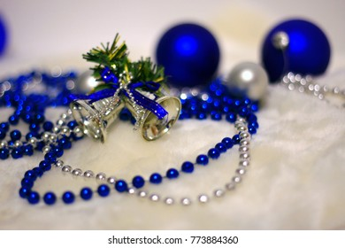 Blue and silver Christmas balls and beads on a white fur background, Christmas and New Year background