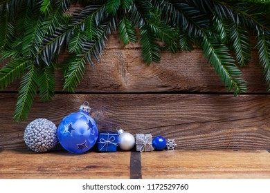 blue and silver christmas balls on wooden board, christmas background with copy space