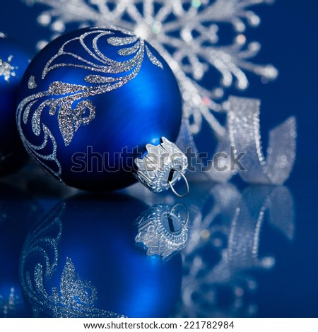 blue and silver christmas ornaments on dark blue xmas background with space for text - Blue And Silver Christmas Ornaments