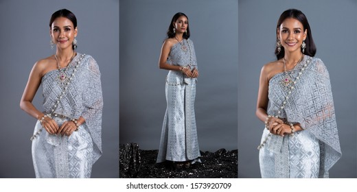 Blue Silver Dress of Thai Traditional Costume or South East Asia gold in Asian Woman with decoration stand act in many poses under Studio lighting grey background, collage group pack