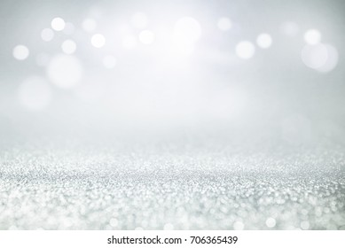 blue and silver glitter lights bokeh abstract background holiday. defocused.