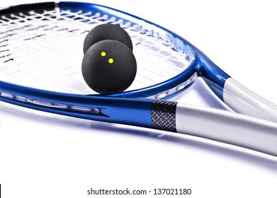 Blue and silver squash racket and ball on a white background with space for text